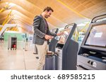 happy man using the check in... | Shutterstock . vector #689585215