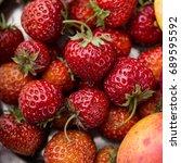 bunch of fresh strawberries... | Shutterstock . vector #689595592