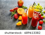 delicious juices in bottles and ...   Shutterstock . vector #689613382