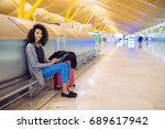 woman at the airport using... | Shutterstock . vector #689617942