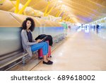 woman at the airport using... | Shutterstock . vector #689618002