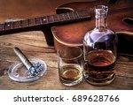 bottle  glass of whiskey  cigar ... | Shutterstock . vector #689628766