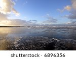sunset at the beach in...   Shutterstock . vector #6896356
