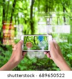 woman using a smart device with ... | Shutterstock . vector #689650522