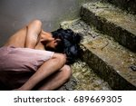 Small photo of poor child lay down on dirty floor in slum.people begging you for help concept for poverty or hunger people, Human Rights,background text.