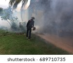 officers spray mosquitoes smoke.   Shutterstock . vector #689710735