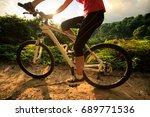 woman cyclist cycling mountain... | Shutterstock . vector #689771536
