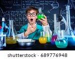smart boy scientist making... | Shutterstock . vector #689776948