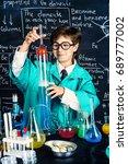 smart boy scientist making... | Shutterstock . vector #689777002