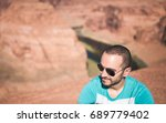 handsome young man with... | Shutterstock . vector #689779402