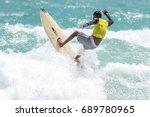 july 29  unidentified surfer in ... | Shutterstock . vector #689780965