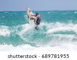 july 29  unidentified surfer in ... | Shutterstock . vector #689781955