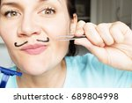 girl gets rid of hair on the...   Shutterstock . vector #689804998
