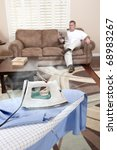 a man sit on his couch while... | Shutterstock . vector #68983267