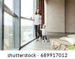 little girl learns to walk with ... | Shutterstock . vector #689917012