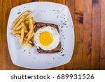 egg  steak and fries breakfast  ... | Shutterstock . vector #689931526