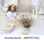 girl in a wreath holding a... | Shutterstock . vector #689937262