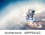 spaceman on flying board. mixed ... | Shutterstock . vector #689956162