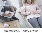woman in hypnosis lying on... | Shutterstock . vector #689957692