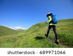 woman hiker hiking on grassland ... | Shutterstock . vector #689971066