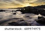 golden sunset at teluk bayu ... | Shutterstock . vector #689974975