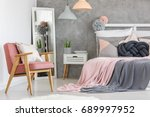 pink armchair with decorative... | Shutterstock . vector #689997952