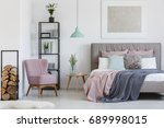 pink comfy armchair placed in... | Shutterstock . vector #689998015