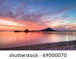 wooden pier on tropical Kanawa Island at dusk - stock photo