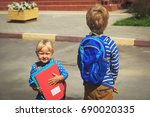 little boy and girl with... | Shutterstock . vector #690020335