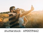young couple taking a selfie... | Shutterstock . vector #690059662