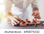 preparation of cakes with... | Shutterstock . vector #690075232