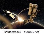 spaceman in cosmos  | Shutterstock . vector #690089725