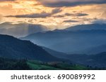 the layer of mountain in sunset ... | Shutterstock . vector #690089992