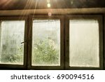 old dirty window with a green... | Shutterstock . vector #690094516