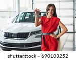 smiling car salesman handing... | Shutterstock . vector #690103252