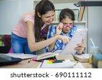 teenage girls studying science... | Shutterstock . vector #690111112