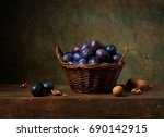 Still Life With Black Plums In...