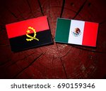 Small photo of Angolan flag with Mexican flag on a tree stump isolated