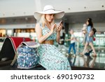 young female passenger at the... | Shutterstock . vector #690190732