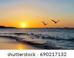 inspirational seagulls flying... | Shutterstock . vector #690217132