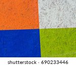 Small photo of Multicolored background, wooden painted surface. Inhomogeneous texture