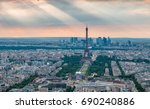 eiffel tower with god rays in... | Shutterstock . vector #690240886