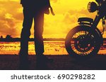 silhouette of biker man with...