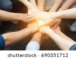 group of people united hands to ... | Shutterstock . vector #690351712