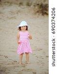 girl in desert. young blonde... | Shutterstock . vector #690374206