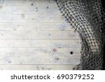Fishing nets on wooden background. Still-life and objects. - stock photo