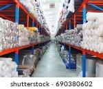 rolls fabric in warehouse | Shutterstock . vector #690380602