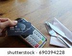 contactless payment card pdq... | Shutterstock . vector #690394228