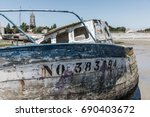 wreck at the boat cemetery at... | Shutterstock . vector #690403672