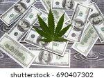 marijuana  dollars against a... | Shutterstock . vector #690407302
